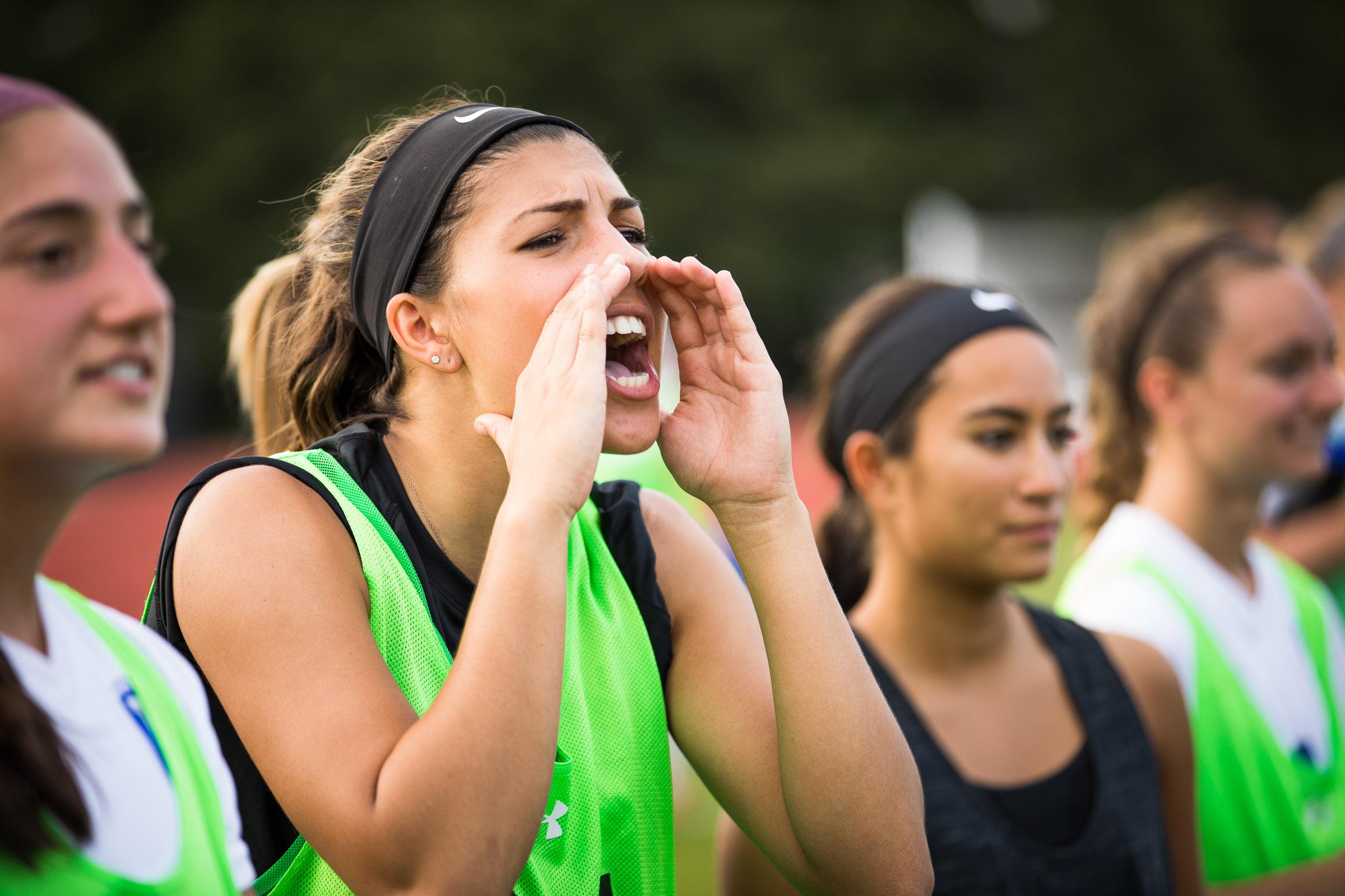student athletes yelling on sideline