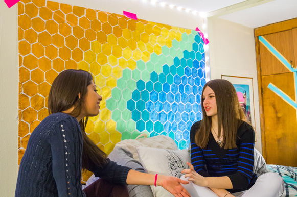 two women talk together in women's leadership community dorm