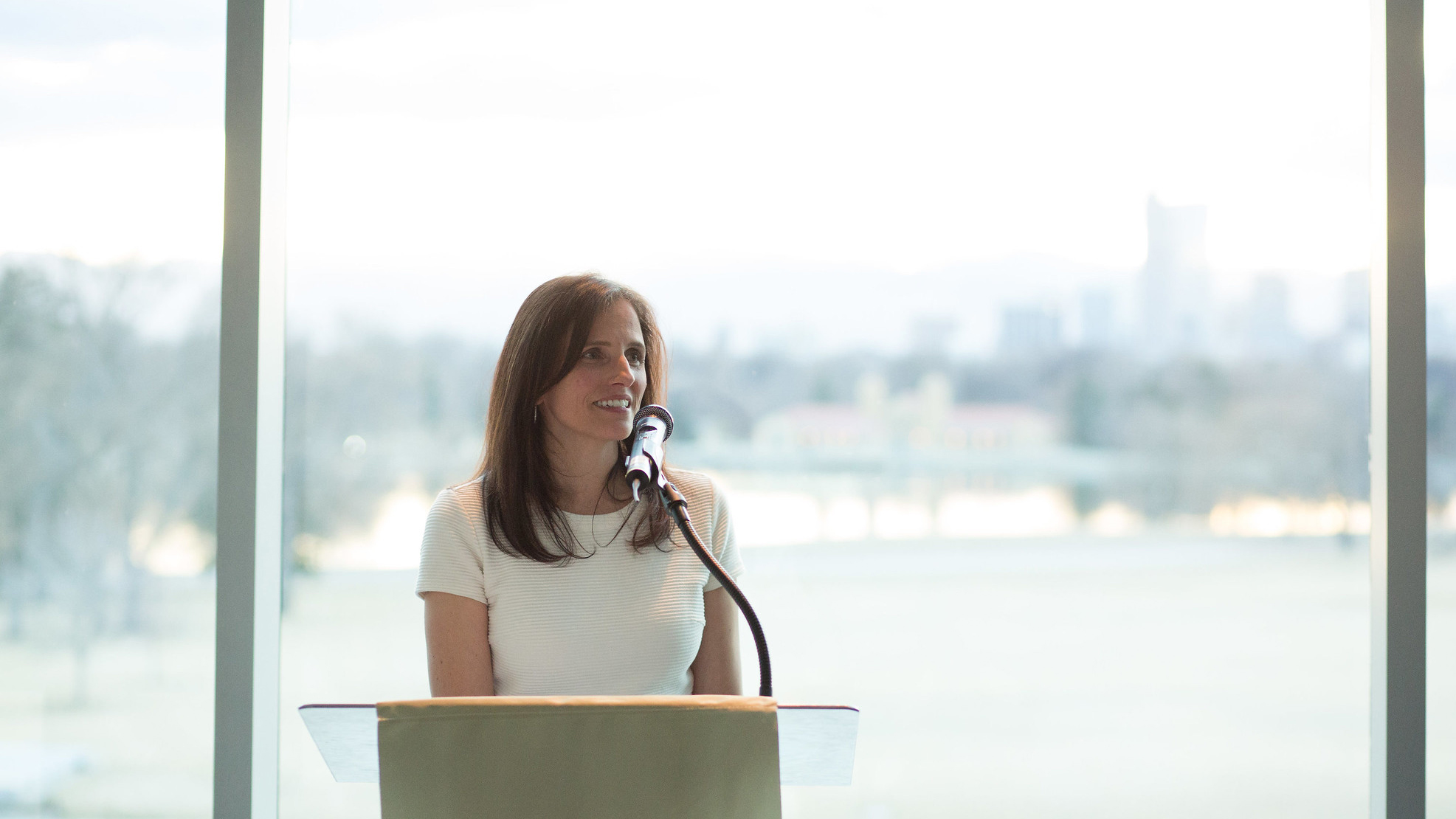 Alumna host speaking at an event