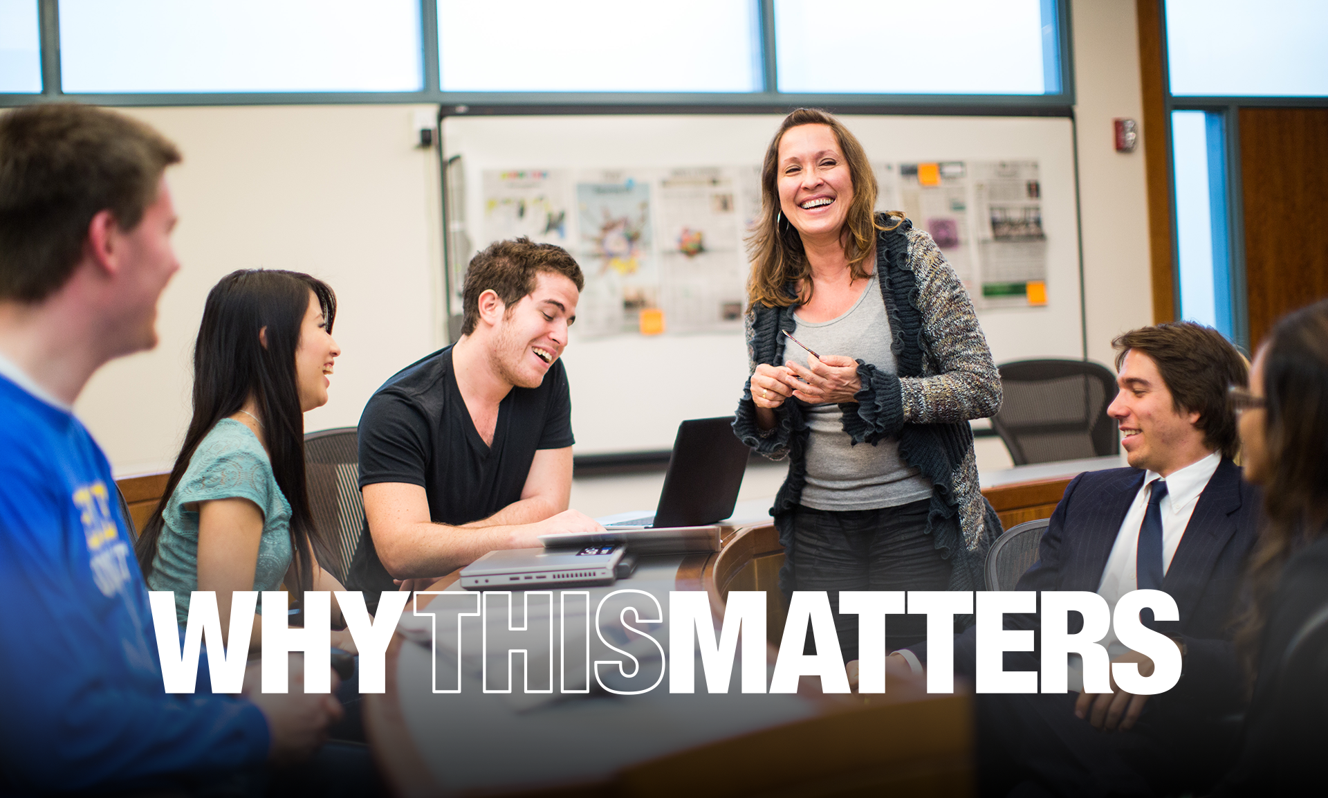 Why This Matters logo over image of students and professor laughing in classroom