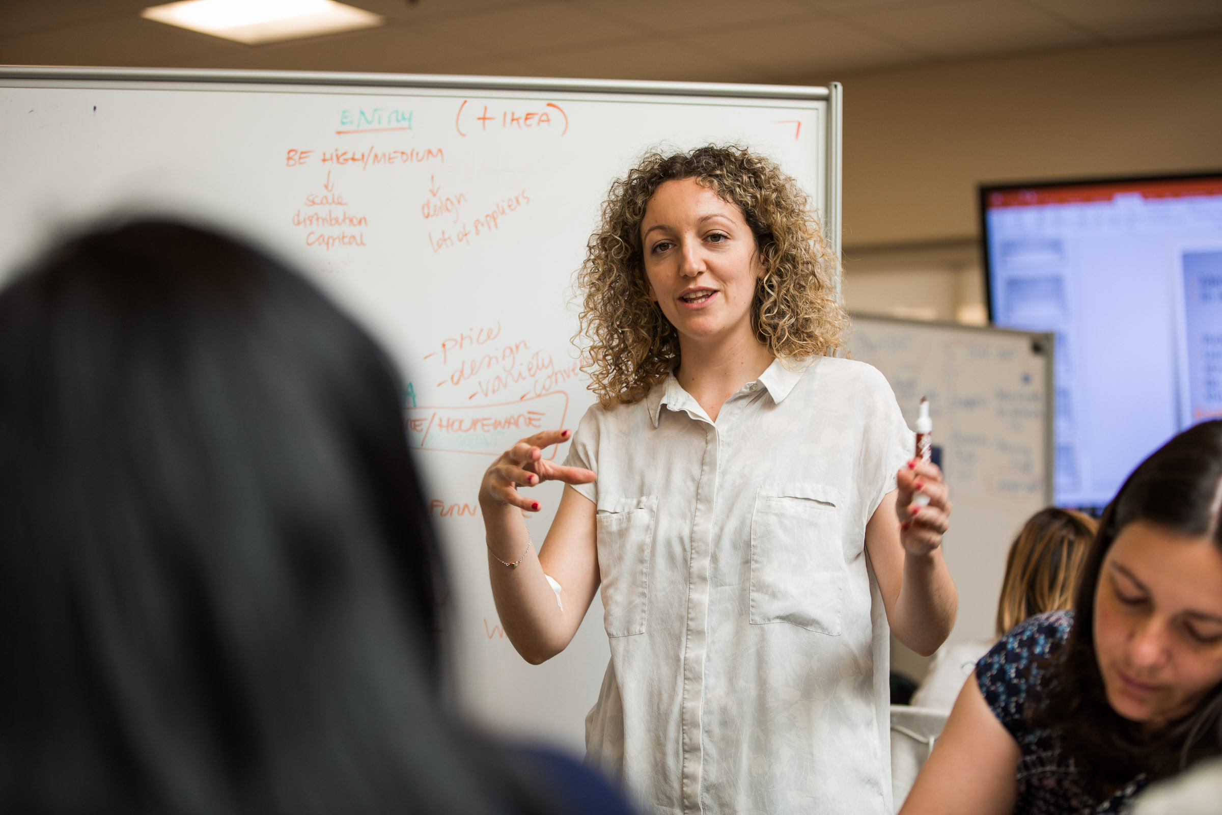 woman leading classroom