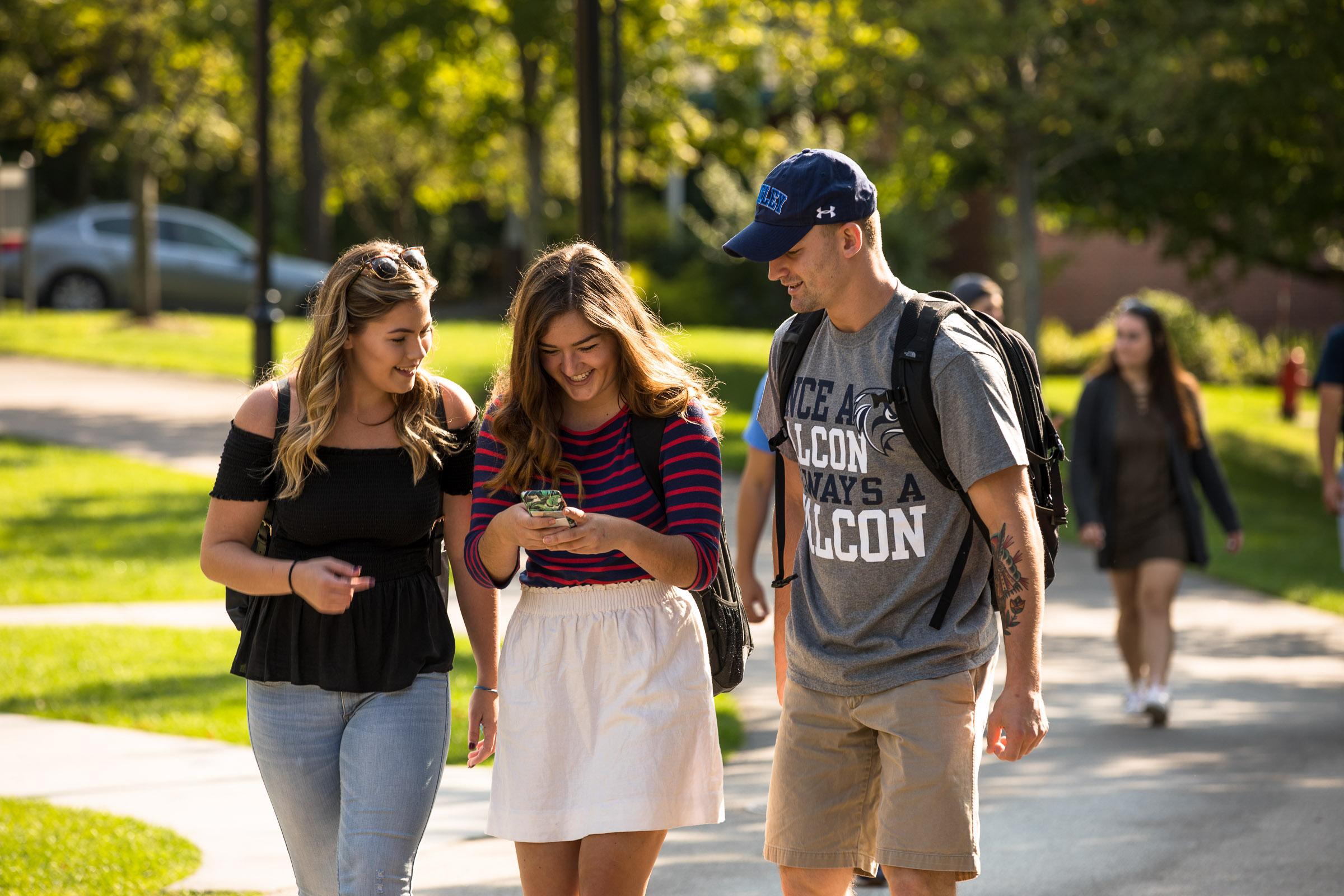 three students walk on campus