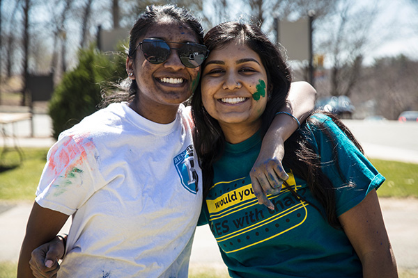 Two Bentley students covered in colors during Festival of Colors Holi event