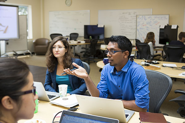 Employees at an Executive Education program engage in a group discussion