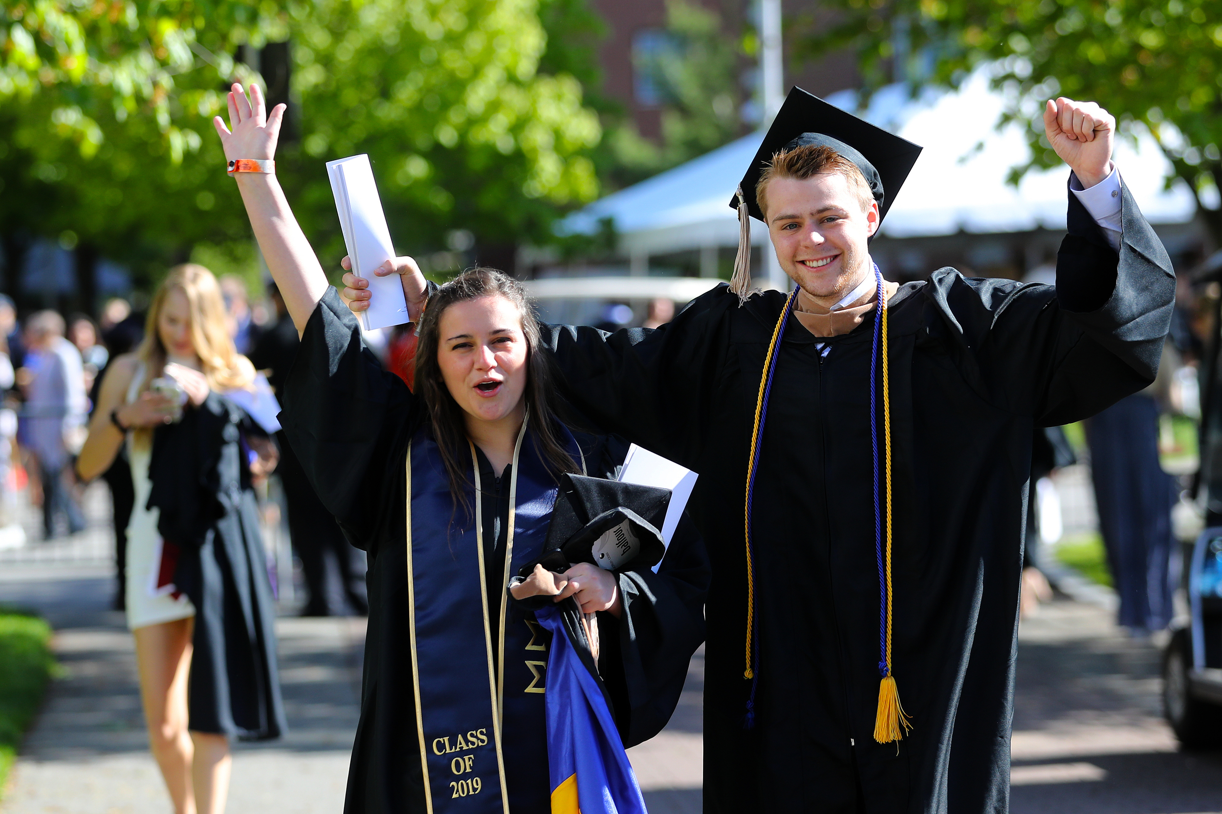 Bentley graduates celebrating at Commencement