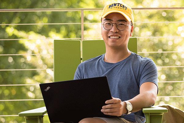 Bentley student working on his laptop