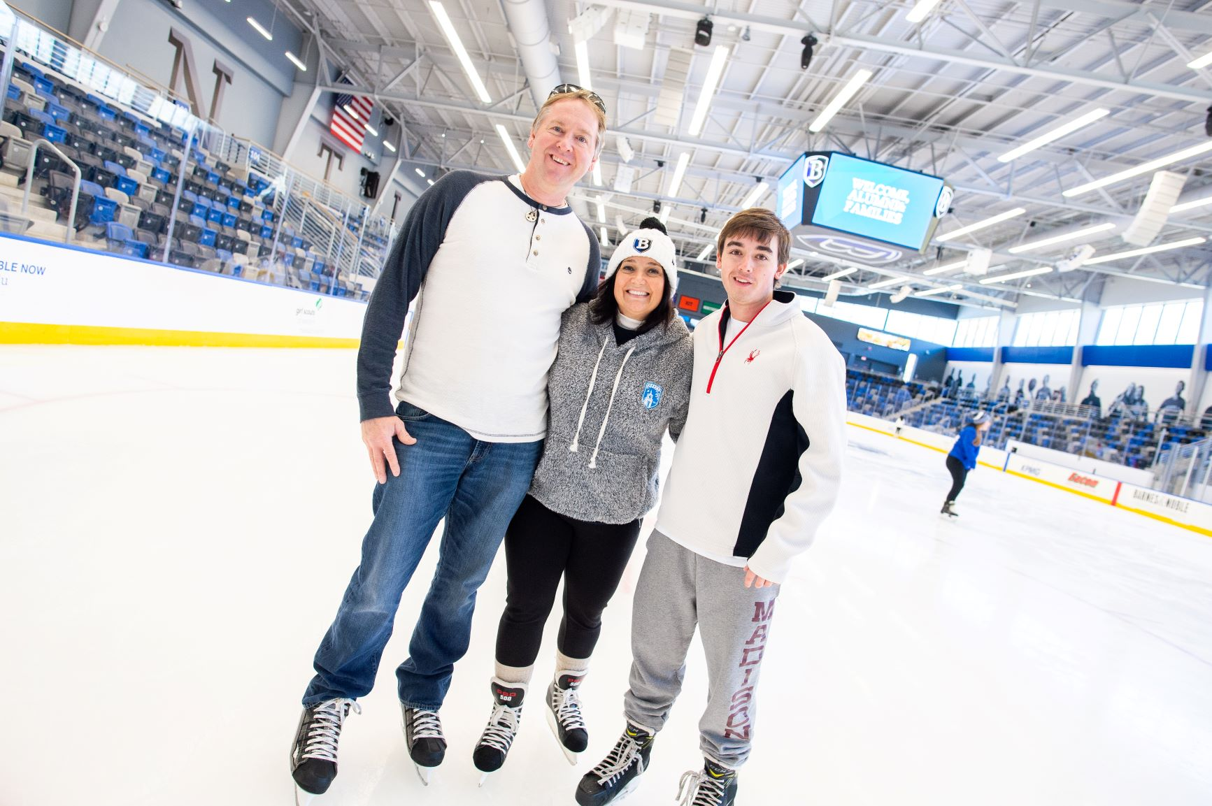 family on hockey rink