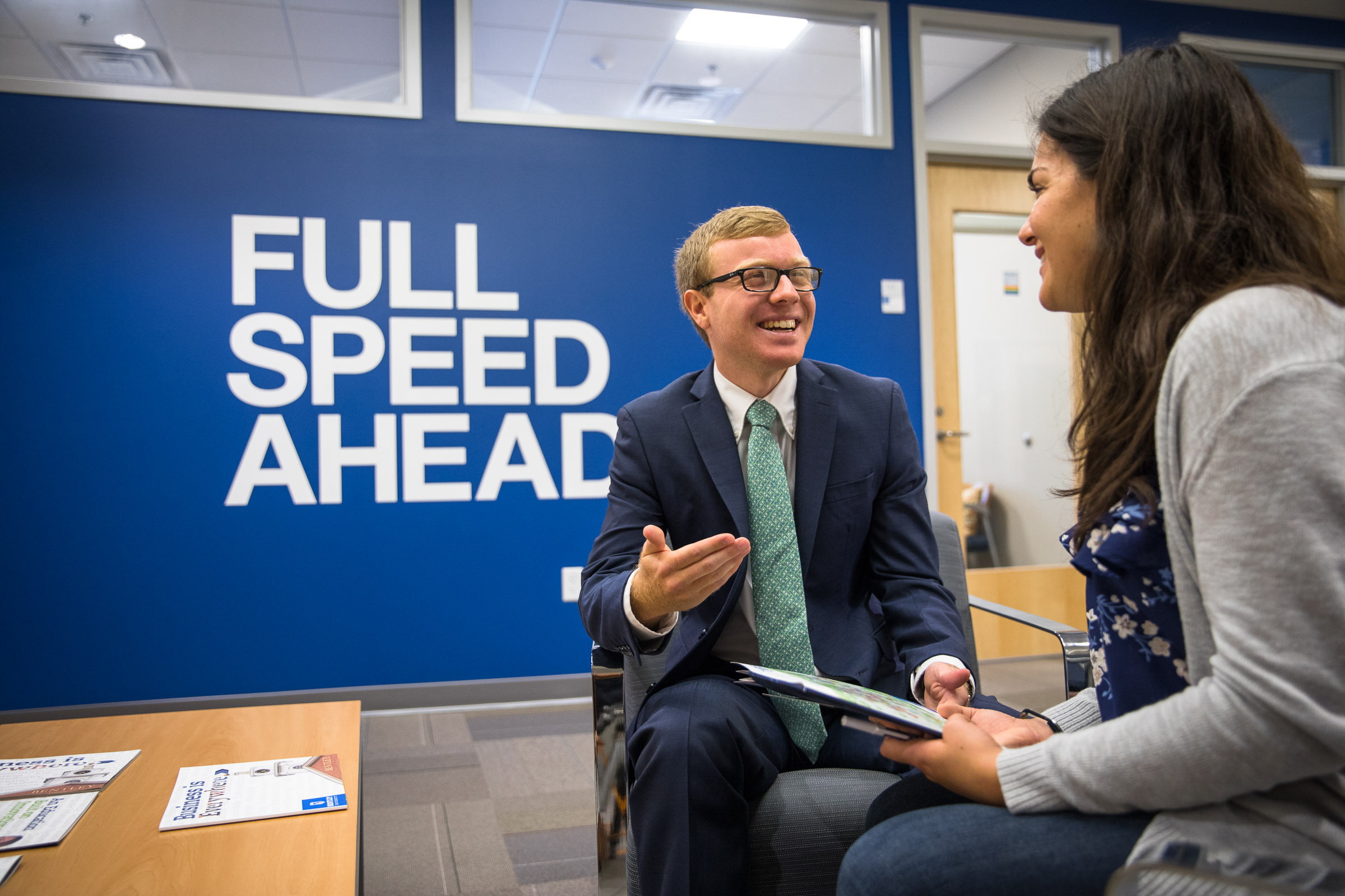 Students talking in career services office