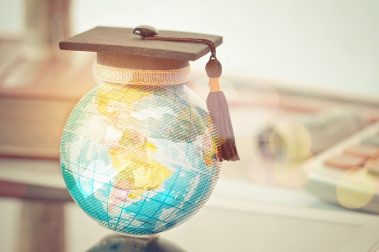Globe with graduation cap on top