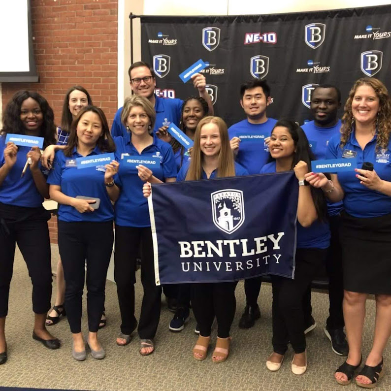 Graduate Admission Team holding Bentley banner