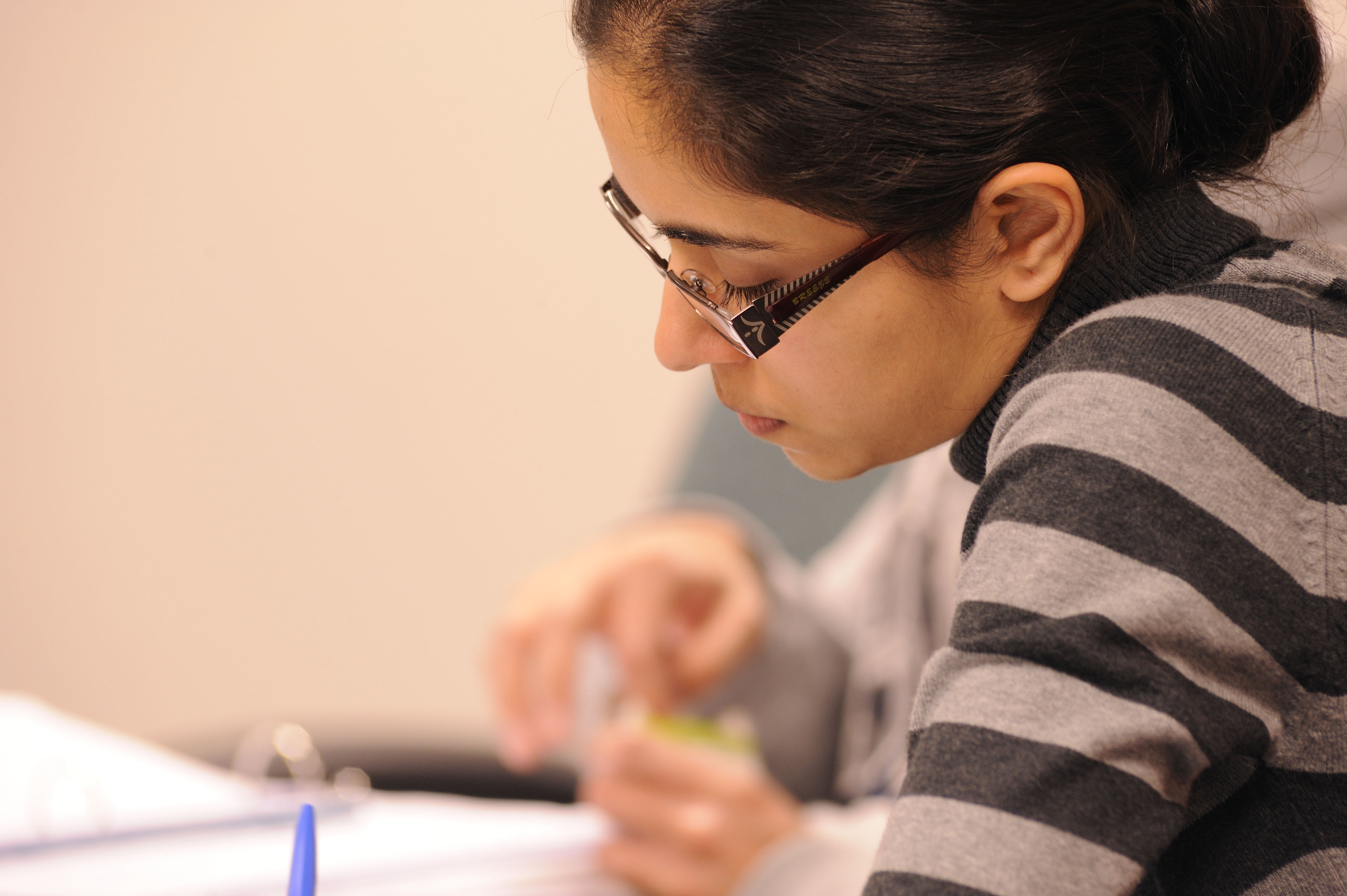 Female student writing on paper