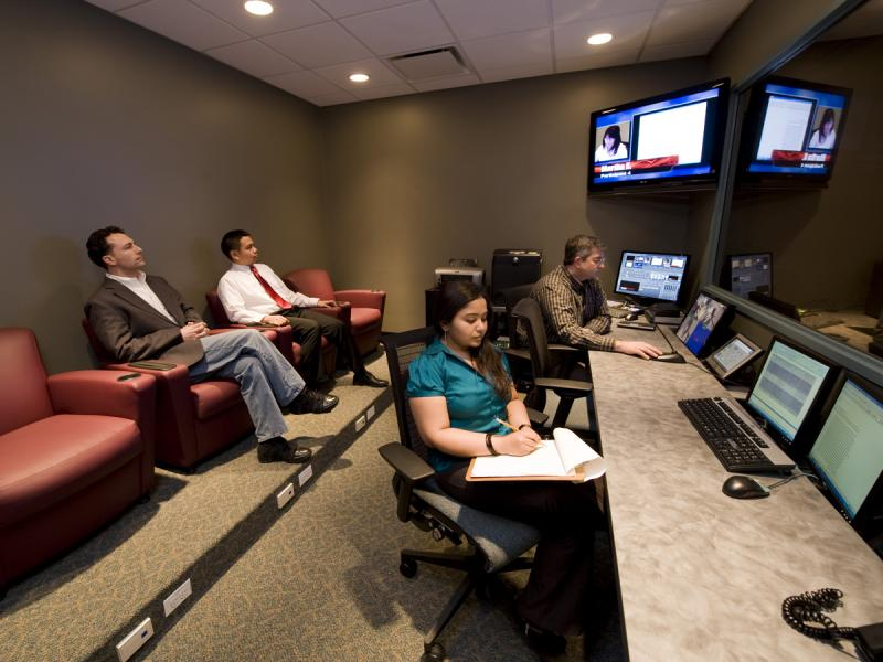 Clients in an observation room observing a usability testing session.