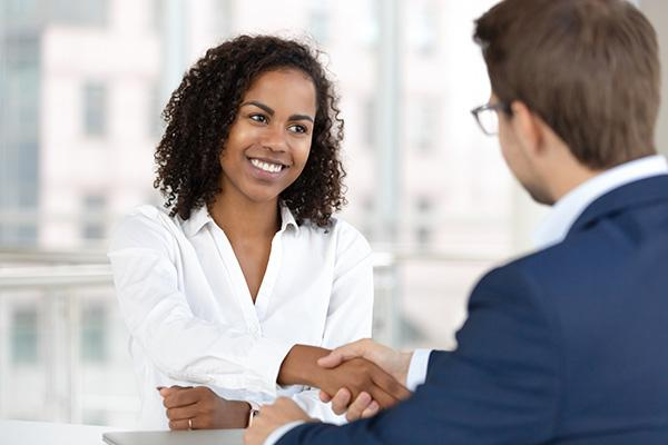 Handshake hire candidate at job interview